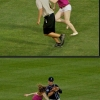 So this girl run in the field to touch players butts
